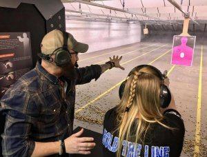 Cody training female shooter.