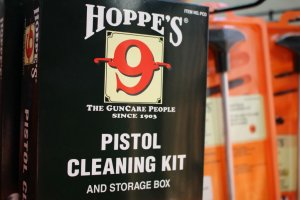 Family Armory & Indoor Range: Firearm cleaning kits for sale on retail floor.